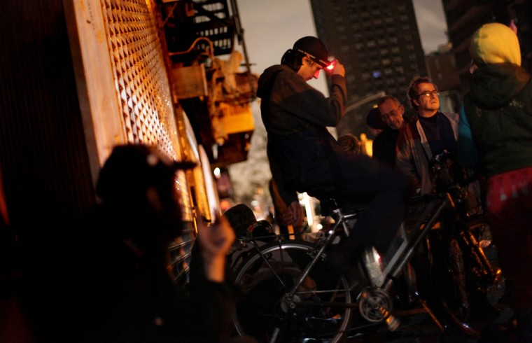 A man rides a bicycle in to generate electricity so New York City residents can charge their cell phones after Hurricane Sandy left them without power. The storm caused massive flooding across much of the Atlantic seaboard, leaving millions of people without power. (Allison Joyce/Getty Images)