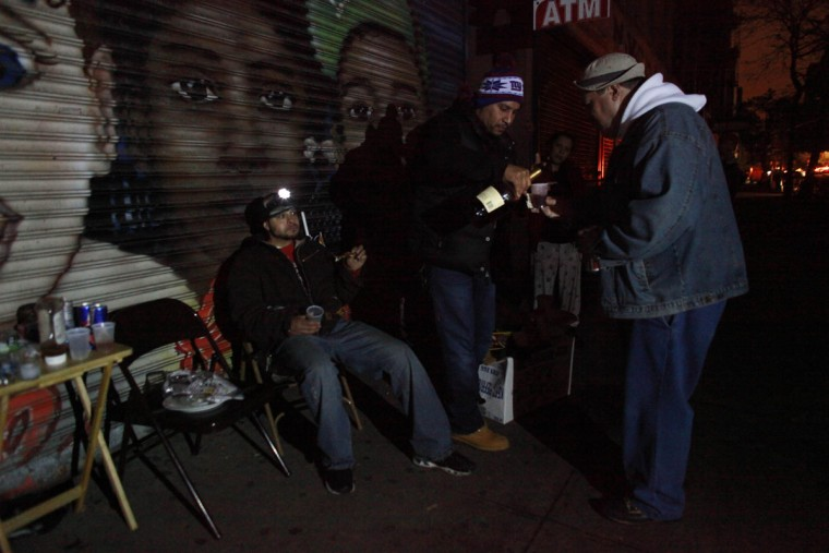 New York City residents have a party on the sidewalk during a blackout after Hurricane Sandy. The storm caused massive flooding across much of the Atlantic seaboard, leaving millions of people without power. (Allison Joyce/Getty Images)