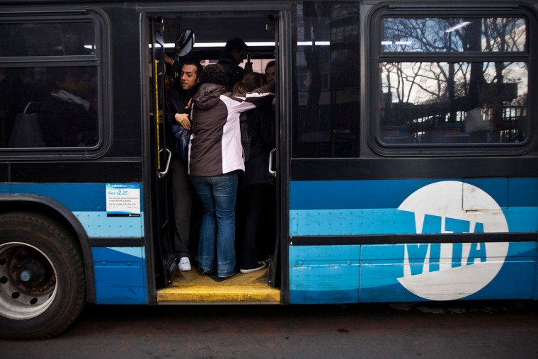 People attempt to fit onto a crowded bus on First Avenue in New York City. With New York's subway system closed due to the aftermath of Sandy, residents and businesses are relying on buses as they attempt to return to their daily lives and normal operations. (Andrew Burton/Getty Images)