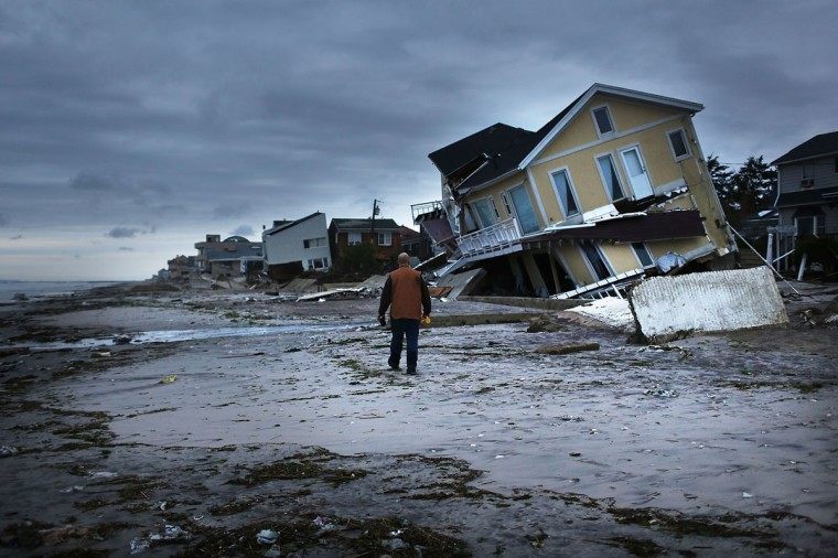Damage is viewed in the Rockaway neighborhood where the historic boardwalk was washed away during Hurricane Sandy on October 31, 2012 in the Queens borough of New York City. (Spencer Platt/Getty Images)