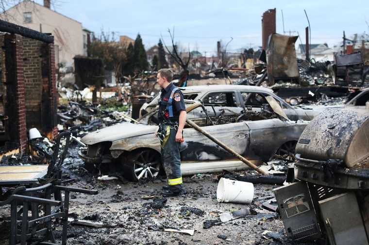 A firefighter stands among the remains of homes burned down in the Rockaway neighborhood during Hurricane Sandy on October 31, 2012 in the Queens borough of New York City. (Spencer Platt/Getty Images)