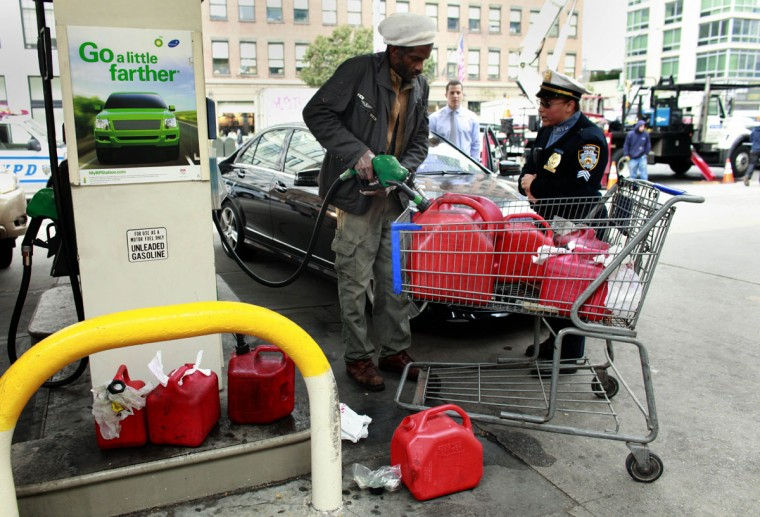 A man is confronted for cutting the line at a BP gas station October 31, 2012 in New York City. (Allison Joyce/Getty Images)