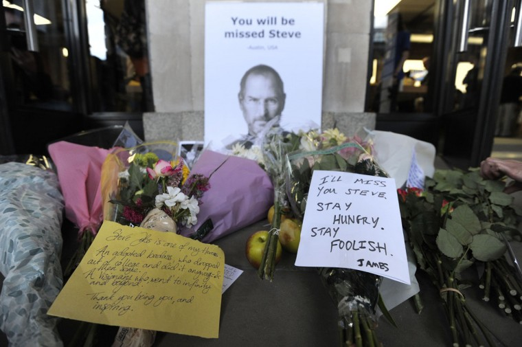 October 6, 2011: Notes are left with flowers and apples outside the Apple store in Covent Garden, central London, following the death of Steve Jobs, co-founder and former chief executive of US technology giant Apple, at the age of 56. (Carl Court/AFP/Getty Images)