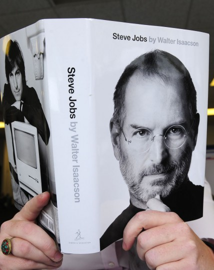 October 24, 2011: A biography of Apple co-founder Steve Jobs is pictured held by a reader in New York. The eagerly awaited biography of Apple co-founder Steve Jobs hit bookstores, painting a candid portrait of a technology visionary who could be as bruising as he was brilliant. (Emmanuel Dunand/AFP/Getty Images)