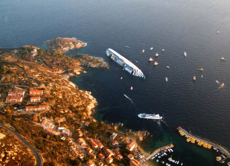 A handout aerial view taken and released on January 14, 2012 by Italian Guardia de Finanza shows the Costa Concordia, after the cruise ship ran aground and keeled over off the Isola del Giglio, on late January 13. Three people died and several were missing after the ship with more than 4,000 people on board ran aground. (Italian Guardia de Finanza via AFP/Getty Images)