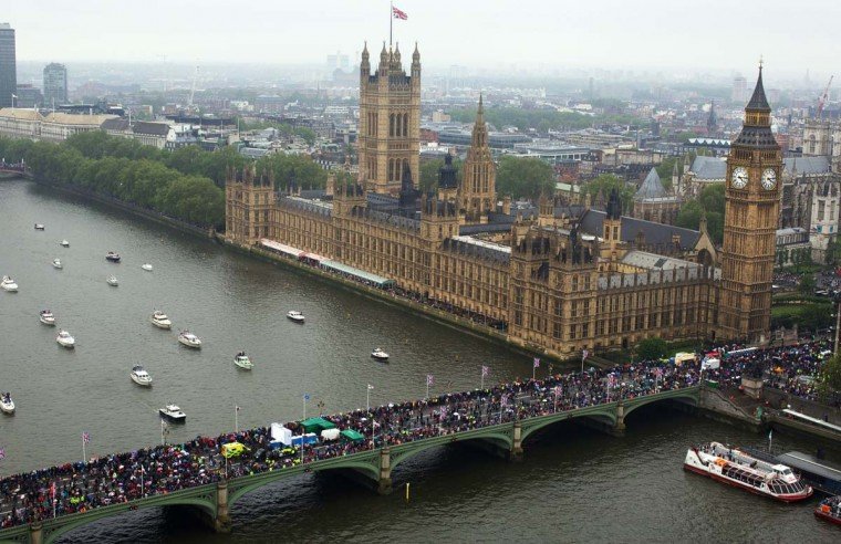 This aerial view shows spectators crowding Westminster Bridge watching of the 1,000 vessels of all shapes and sizes sailing down the River Thames during the Diamond Jubilee river Pageant in London on June 3, 2012. (Andrew Cowie/AFP/Getty Images)