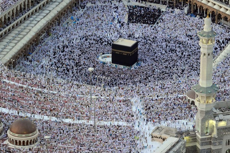 An aerial view shows Muslim pilgrims walking around the Kaaba in the Grand Mosque of the holy city of Mecca on August 6, 2012. All over the world Muslims are performing one of the five pillars of Islam as they fast from dawn to dusk during the holy month of Ramadan. (Amer Hilabi/AFP/Getty Images)