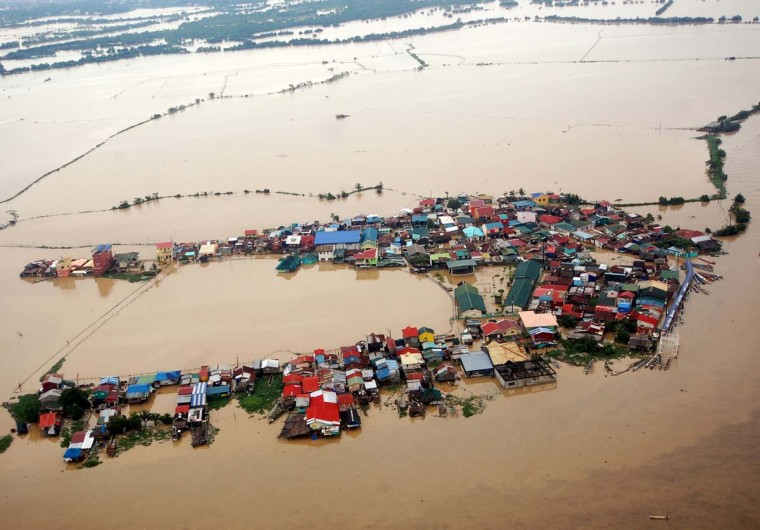 This handout photo taken on August 8, 2012 and released by the Department of National Defense (DND) shows an aerial shot of flooding around Bulacan, north of Manila. More than a million people in and around the Philippine capital battled deadly floods on August 8, as more monsoon rain fell. (AFP/Getty Images)