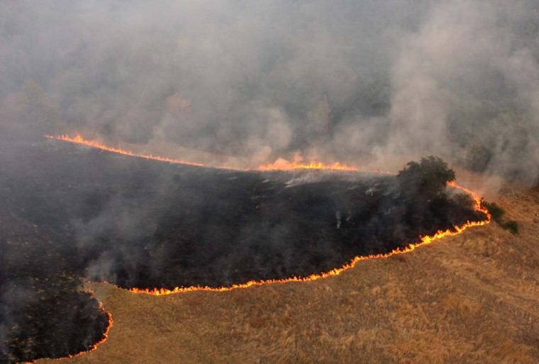 A picture taken on August 22, 2012 shows an aerial view of a mountain fire in the village Dubovo, near southern Serbian town of Zitoradja. An unprecedented drought that has hit the Balkans dealt a serious blow to agriculture, causing grave losses estimated at more than a billion euros in one of the poorest European regions, officials said Saturday. (Nebojsa Markovic/AFP/Getty Images)