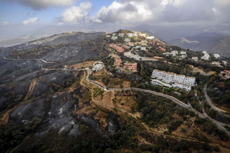 An aerial view of the town of Coin and its surroundings, near Malaga, after the passage of a wildfire, on September 1, 2012. (Pedro Armestre/AFP/Getty Images)