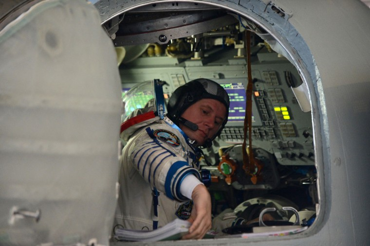 September 21, 2012: One of the crew members of the next expedition to the International Space Station (ISS), Russian cosmonauts Oleg Novitskiy, sits inside a mock-up of a Soyuz TMA space craft during his final preflight practical examination at the Cosmonaut Training Centre in Star City, outside Moscow. (Kirill Kudryavtsev/AFP/GettyImages)