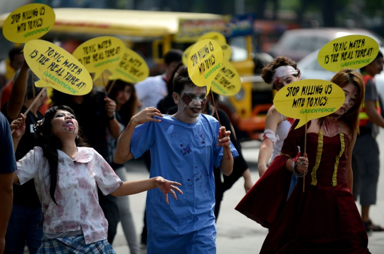 "Members of Greenpeace together with environmental advocates dressed as zombies attend a creative protest against water pollution in Manila on September 27, 2012. The protesters delivered a petition urging the establishment of a ""Right-To-Know"" system for chemicals and the adoption of a policy to eliminate hazardous chemicals released by factories into freshwater bodies. (Noel Celis/AFP/Getty Images)"