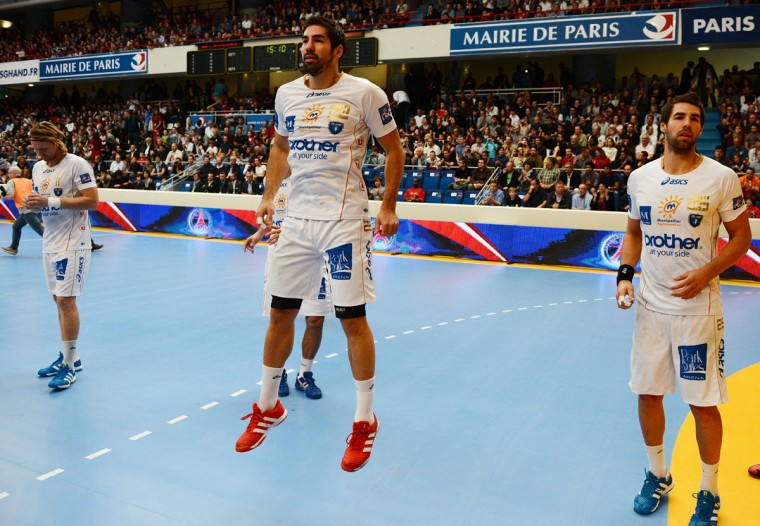 Montpellier's player Nikola Karabatic (C) and and his brother Luka Karabatic (R) are pictured before the French D1 handball match PSG vs Montpellier, on September 30, 2012 at Pierre de Coubertin Arena in Paris. (Franck Fifer/AFP/Getty Images)