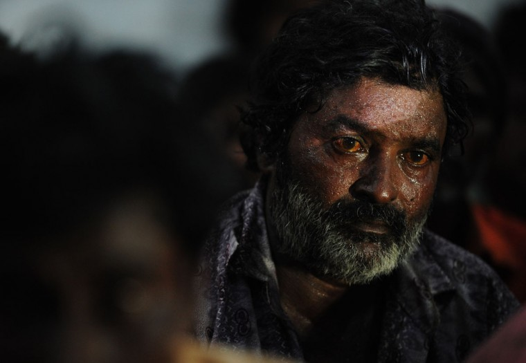 An arrested Indian fisherman sits at a police station in Pakistan's port city of Karachi on October 1, 2012. Pakistan maritime security agency have arrested 33 Indian fishermen and seized five boats for allegedly fishing illegally in Pakistan's territorial waters. (Asif Hassan/AFP/Getty Images)