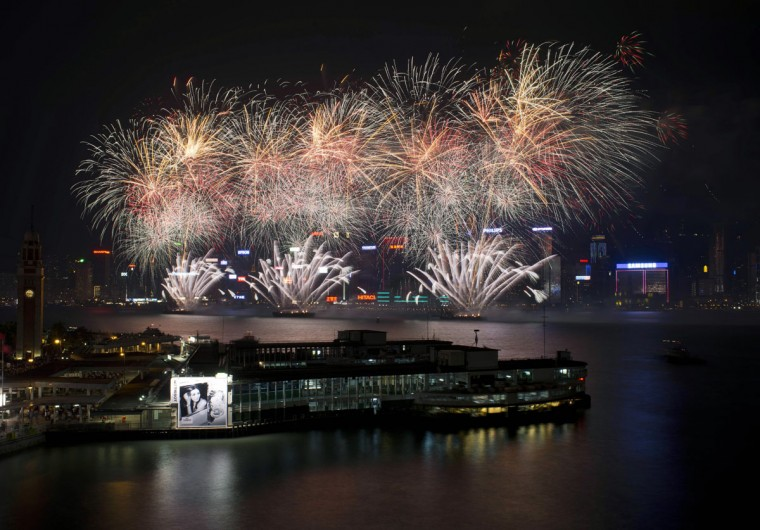 Fireworks explode over Victoria Harbor to celebrate the 63rd anniversary of the founding of the People's Republic of China, in Hong Kong on October 1, 2012. The anniversary is also known as National Day. (Antony Dickson/AFP/Getty Images)