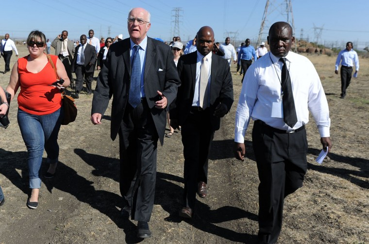 Judge Ian Farlam, chairperson of the Marikana commission of inquiry, flanked by members of the commission, visits the Marikana site outside Lonmin mine on October 1, 2012 in Rustenburg during the opening of an inquiry into the police killing of 34 miners and related violence in August 16. (Stringer/AFP/Getty Images)