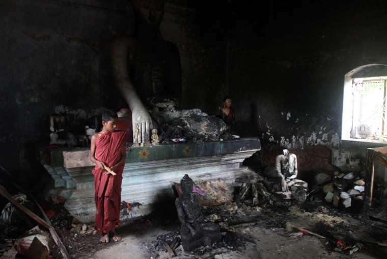 A Buddhist monk looks on in a burnt temple in Cox's Bazar, some 396 kilometres (246 miles) from the capital Dhaka. Bangladesh police said they had arrested nearly 300 people after Muslim mobs attacked temples and houses in what Buddhist leaders described as the worst violence against the community since independence. (STR/AFP/Getty Images)