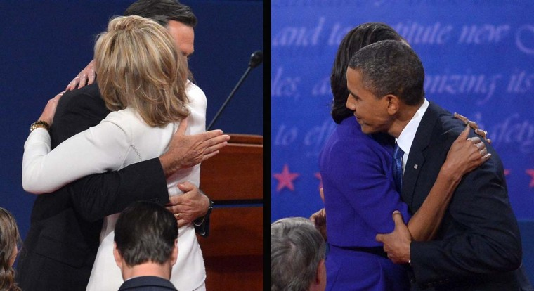 This combination of images show U.S. President Barack Obama and Republican presidential candidate Mitt Romney embracing their spouses after the first presidential debate at the university of Denver on October 3, 2012 in Denver, Colorado. (Jewel Samad/AFP/Getty Images)