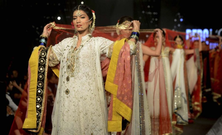 Models present creations by Pakistani designers Asifa and Nabeel on the second day of the Pakistan Fashion Design Council (PFDC) Bridal Week in Lahore (Arif Alia/Getty Images)