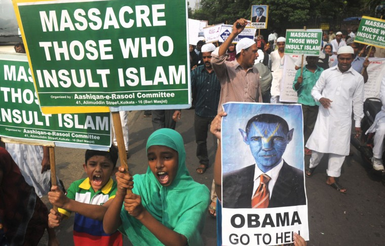 """Indian Muslim children hold anti-US placards as they participate in a protest meeting against the film """"Innocence of Muslims"""" in Kolkata. A low-budget, US-produced """"Innocence of Muslims"""" movie has incited a wave of bloody anti-US violence in Libya, Egypt, Sudan, Tunisia, Yemen and in several other countries across the Muslim world. (Dibyangshu Sarkar/AFP/Getty Images)"""
