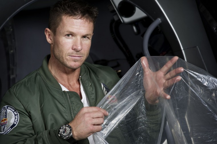 February 23, 2012: In this image obtained from www.redbullcontentpool.com, pilot Felix Buamgartner of Austria shows a piece of the balloon material during the Red Bull Stratos egress training in Lancaster, California, USA. (Joerg Mitter/AFP/Getty Images)