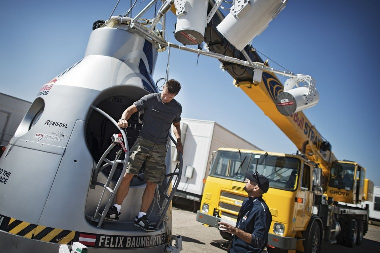 October 5, 2012: In this image obtained from www.redbullcontentpool.com, pilot Felix Baumgartner of Austria stands outside his capsule during the preparations for the final manned flight of the Red Bull Stratos mission in Roswell, New Mexico. (Joerg Mitter/AFP/Getty Images)