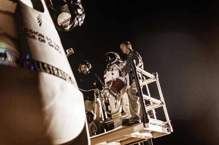 October 6, 2012: In this image obtained from www.redbullcontentpool.com, pilot Felix Baumgartner (C) of Austria stands on a forklift in front of his capsule during the preparation for the final manned flight of Red Bull Stratos in Roswell, New Mexico. (Balazs Gardi/AFP/Getty Images)