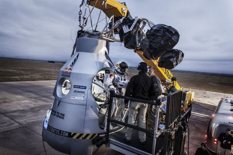 October 6, 2012: In this image obtained from www.redbullcontentpool.com, pilot Felix Baumgartner (C) of Austria stands on the step of his capsule during the preparation for the final manned flight of Red Bull Stratos in Roswell, New Mexico. (Balazs Gardi/AFP/Getty Images)