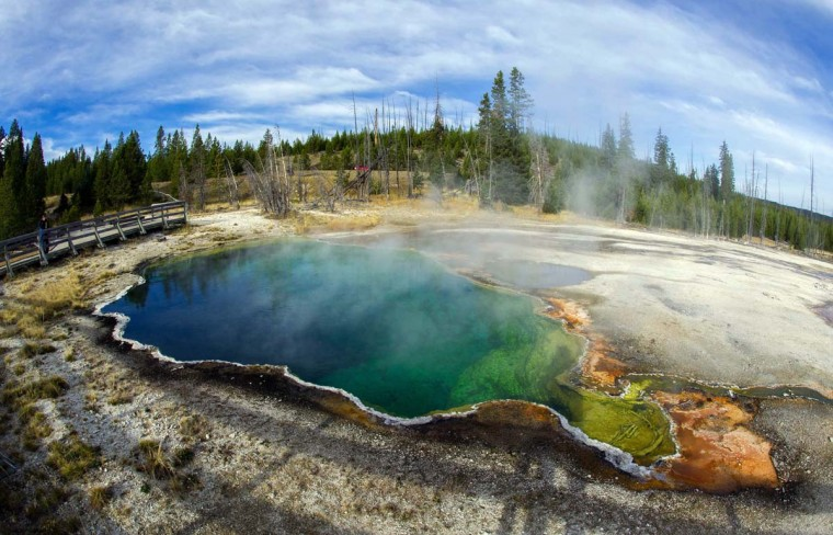 The Abyss geothermal pool is seen October 8, 2012 in Yellowstone National Park in Wyoming. Yellowstone protects about 10,000 geysers, mudpots, steamvents, and hot springs and is America's first national park. It extends through Wyoming, Montana, and Idaho. (Karen Bleier/AFP/Getty Images)