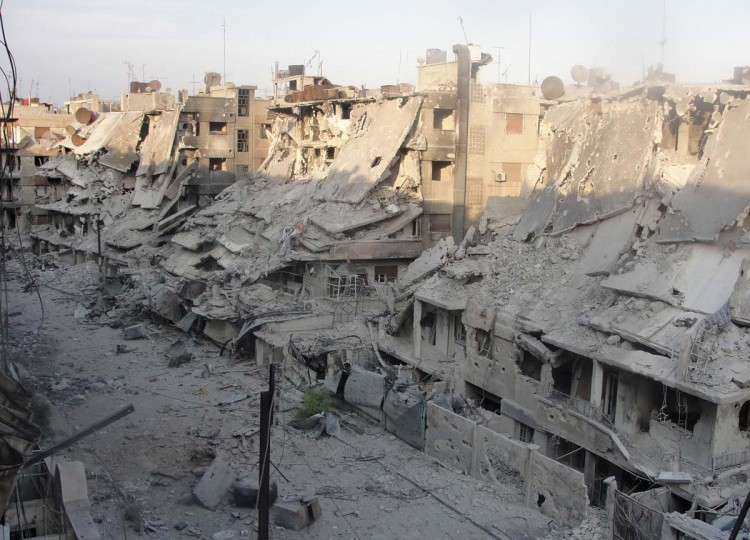 Destroyed buildings in Syria's besieged central city of Homs is seen following fighting between government and opposition forces, on October 7, 2012. (Shaam News Network Handout via AFP)