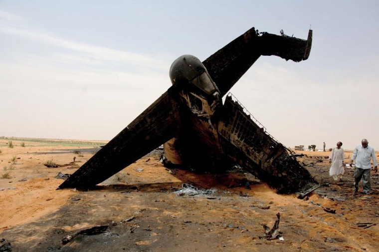 Men inspect the wreckage of a transport plane that crashed on October 7, west of the Sudanese capital Khartoum on October 9, 2012. Fifteen Sudanese military personnel were killed and seven others injured when their transport plane crashed on its way to conflict-plagued Darfur, state media reported. (Stringer/AFP/Getty Images)