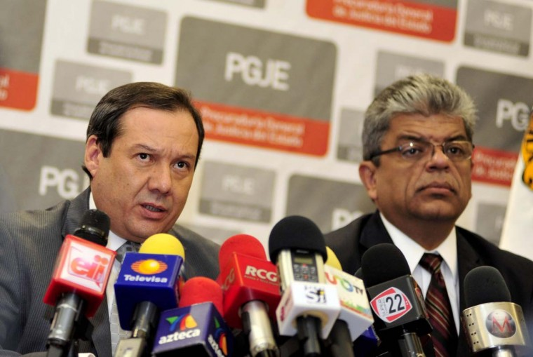Coahuila state prosecutor Homero Ramos (L) speaks during a press conference on the death of Heriberto Lazcano, founder of the Zetas drug cartel, in Saltillo on October 9, 2012. The body of the Lazcano was stolen from a funeral parlor by an armed group after he was killed in a shootout with authorities in northern Mexico, officials said Tuesday. (Julio Cesar Aguilar/AFP/Getty Images)
