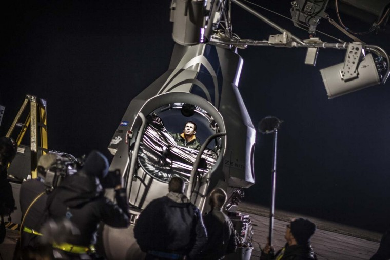 Pilot Felix Baumgartner of Austria sits in his capsule prior to the final manned flight of Red Bull Stratos in Roswell, New Mexico on October 9, 2012. The Austrian daredevil readied for an unprecedented leap from the edge of space on October 9, but weather delays dampened hopes for the sound barrier-breaking free fall. (Joerg Mitter/redbullcontentpool.com via AFP)