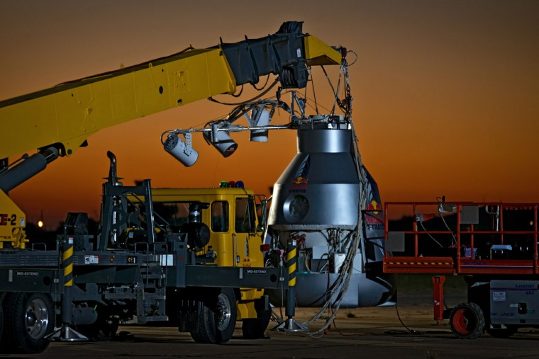 October 9, 2012: This picture provided by www.redbullcontentpool.com shows a crane holding the Red Bull Stratos capsule at the flight line before Austrian pilot Felix Baumgartner takes off in Roswell, New Mexico. (Joerg Mitter/AFP/Getty Images)