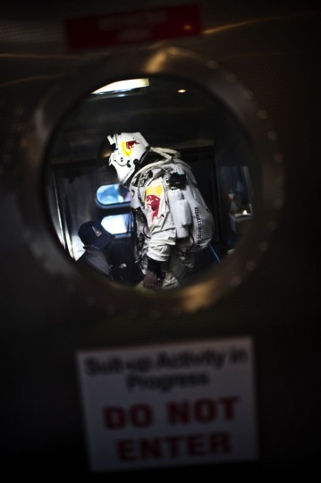 October 9, 2012: This picture provided by www.redbullcontentpool.com shows pilot Felix Baumgartner of Austria gets ready in his trailer before the scheduled take off of Red Bull Stratos in Roswell, New Mexico. (Joerg Mitter/AFP/Getty Images)