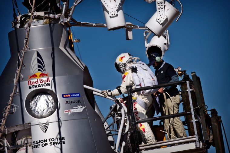 October 9, 2012: This picture provided by www.redbullcontentpool.com shows pilot Felix Baumgartner of Austria stepping into the capsule before the scheduled take off of Red Bull Stratos in Roswell, New Mexico. The Austrian daredevil's attempt to make an unprecedented leap from the edge of space was aborted moments before the planned launch due to gusty winds, organizers said. Baumgartner was already installed in the pressurized capsule, and a five-minute countdown was started, but as it got down to zero it became clear that conditions were too windy. (Joerg Mitter/AFP/Getty Images)
