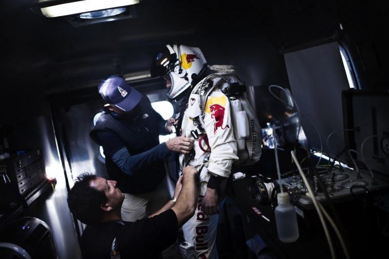 October 9, 2012: This picture provided by www.redbullcontentpool.com shows pilot Felix Baumgartner of Austria getting ready in his trailer before the scheduled take off of Red Bull Stratos in Roswell, New Mexico. (Joerg Mitter/AFP/Getty Images)