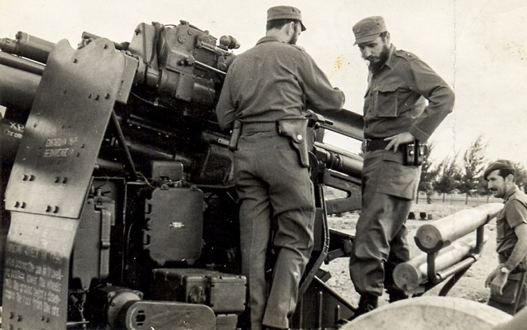 In this photo released by Cuban newspaper Granma, Fidel Castro, right, inspects an artillery unit at an undisclosed place. (Granma/AFP/Getty Images)