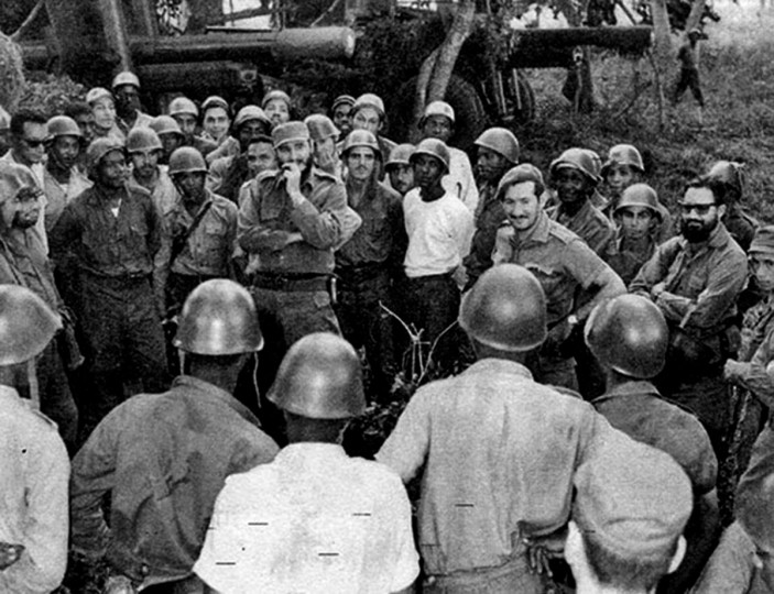 In this photo released by Cuban newspaper Granma, Cuban leader Fidel Castro (center) talks with the crew of a field artillery battery at an undisclosed place during the 1962 missile crisis. (Granma/AFP/Getty Images)