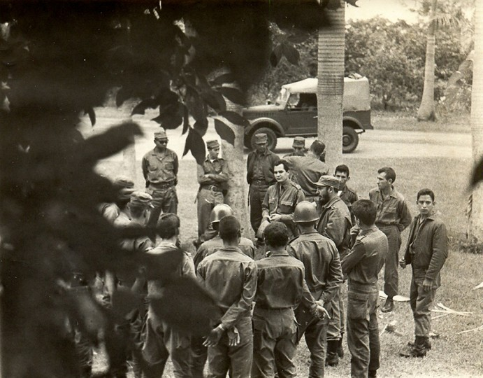 In this photo released by Cuban newspaper Granma, Fidel Castro (right, with beard) talks with soldiers at an undisclosed place during the 1962 missile crisis. (Granma/AFP/Getty Images)