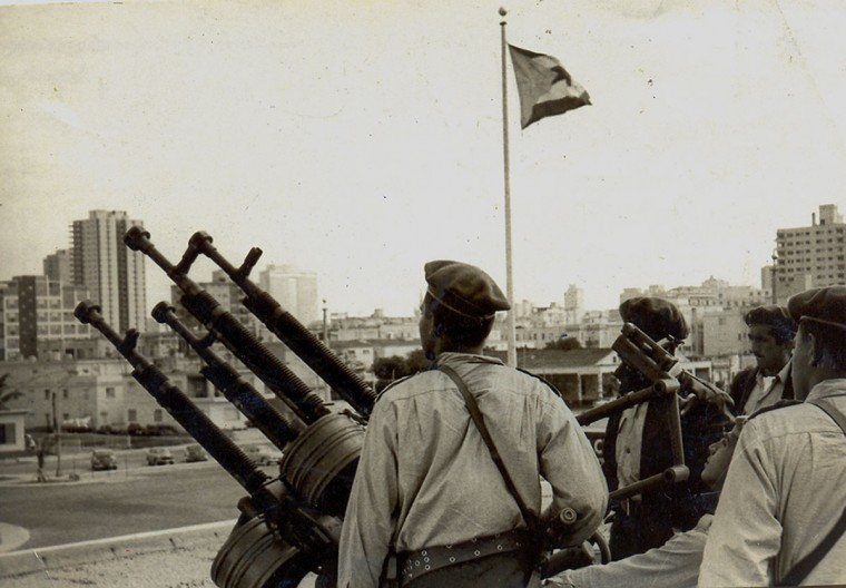 In this photo released by Cuban newspaper Granma, Cuban militiamen man a Czechoslovakian-made anti-aircraft gun at Havana's Malecon during the 1962 missile crisis. (Granma/AFP/Getty Images)