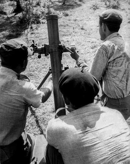 In this handout photo released by Cuban newspaper Granma, Cuban militiamen man an 82-mm field mortar during the 1962 missile crisis. (Granma/AFP/Getty Photo)