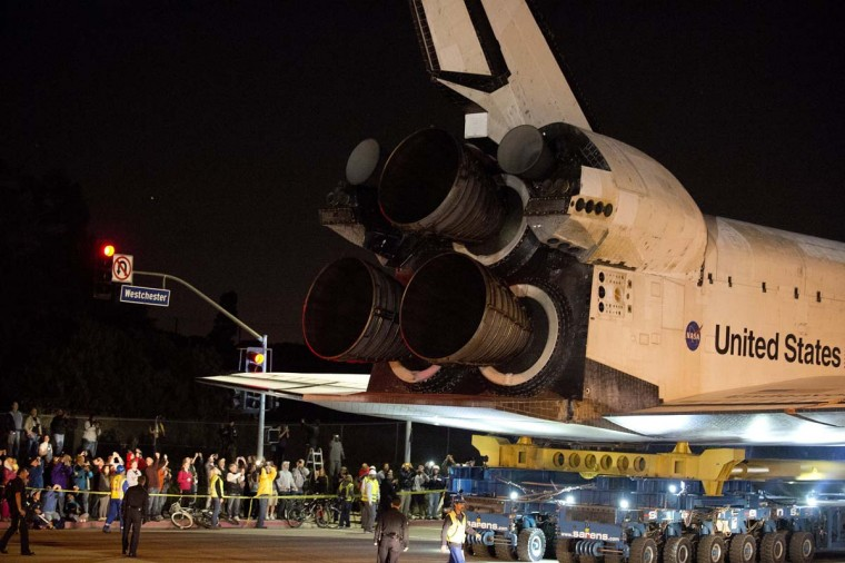 Space Shuttle Endeavour begins its final journey at Los Angeles International Airport (LAX) to its permanent home, in the early morning hours in Los Angeles, California. (Robyn Beck/AFP/Getty Images)
