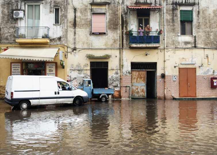 Residents look at a flooded street in downtown Naples following heavy rain in southern Italy. (Robert Salomone/AFP/Getty Images)