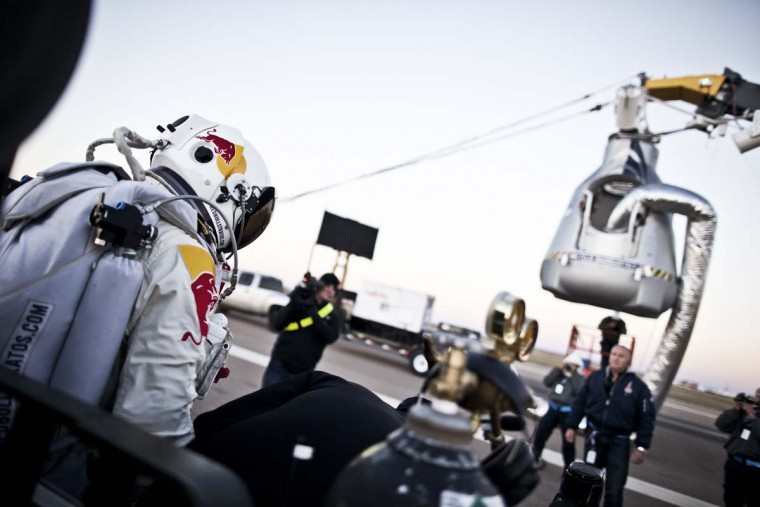This picture provided by redbullcontentpool.com shows Felix Baumgartner of Austria stepping out from his trailer during the final manned flight for Red Bull Stratos in Roswell, New Mexico, USA on October 14, 2012. (Balazs Gardi/AFP/Getty Images)