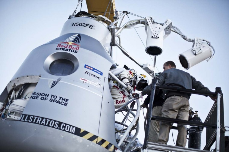 This picture provided by redbullcontentpool.com shows Felix Baumgartner of Austria stepping into the capsule during the final manned flight for Red Bull Stratos in Roswell, New Mexico, USA on October 14, 2012. (Balazs Gardi/AFP/Getty Images)