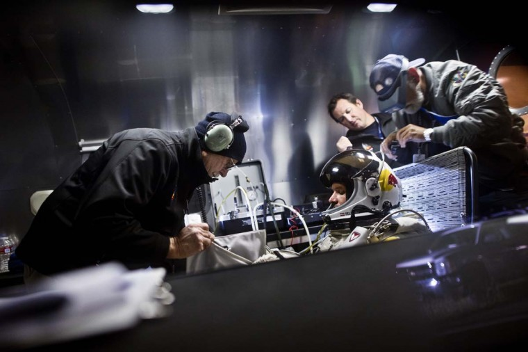 This picture provided by redbullcontentpool.com shows Felix Baumgartner of Austria preparing in his trailer during the final manned flight for Red Bull Stratos in Roswell, New Mexico, USA on October 14, 2012. (Jorg Mitter/AFP/Getty Images)