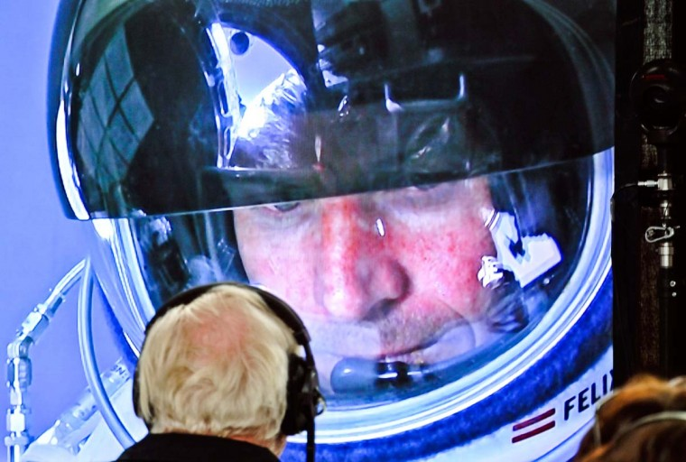 This picture provided by redbullcontentpool.com shows Felix Baumgartner of Austria seen in a screen at mission control center in the capsule during the final manned flight for Red Bull Stratos in Roswell, New Mexico, USA on October 14, 2012. Daredevil Felix Baumgartner lifted off from the New Mexico desert on Sunday, in his second attempt to make a record-breaking jump from the edge of space. Baumgartner was being transported up to 23 miles (37 kilometers) above the Earth by an enormous balloon, before launching himself into the void, aiming to become the first human to break the sound barrier in freefall. (Stefan Aufschnaiter/AFP/Getty Images)