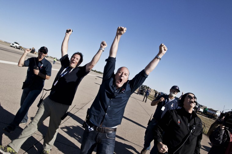 Crew members celebrate the successful launch during the final manned flight for Red Bull Stratos in Roswell, New Mexico, USA. (Balazs Gardi/AFP photo)