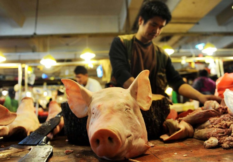 A butcher sorts out his table filled with pork at a market in Qingdao, in eastern China's Shandong province on October 15, 2012. China's inflation rate slowed in September, government data showed on October 15, satisfying an official desire to control price gains, but highlighting overall weakness in the world's second-largest economy. (AFP/Getty Images)